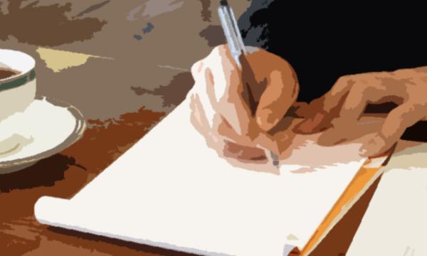 新人はノートとペンでクライアントの話をきちんとメモ